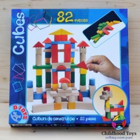 Cuburi din lemn 82piese. Pachetul contine: Cutie cu set de cuburi format din 82 de piese din lemn natur si colorate avand diverse forme geometrice.